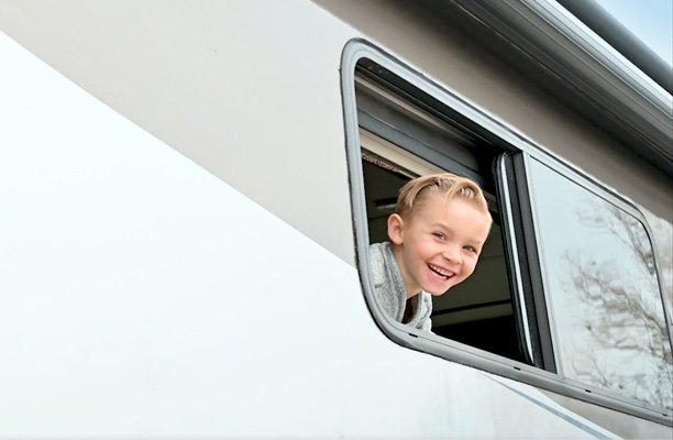 Child looking out RV window
